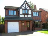 Detached home in Yew Tree Court...