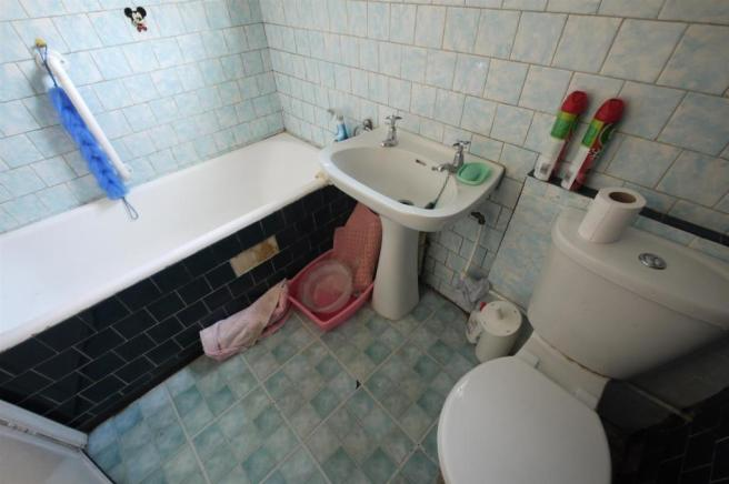 Tiled bathroom:-