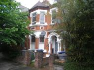 Terraced property in Herbert Gardens, London...