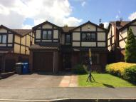 Detached property in Satinwood Close...