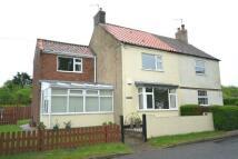 semi detached home in Church Street, Nettleton...