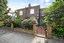 Terraced property in Rowan Road, Brook Green...