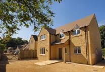 Detached home for sale in Hospital Road...