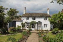 Detached home in Wilmslow Old Road...