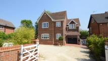 Detached home in Hyde End Road, Shinfield...