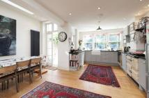 Terraced house to rent in Grandison Road, SW11