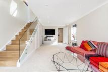 Detached home in Chatto Road, SW11