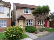 property in The Coombes, Roundswell...