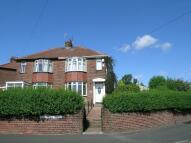 semi detached property in Lobley Hill Road...