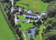 Coombe House & Cottages Detached house for sale