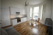 Ground Flat to rent in Barons Court Road...