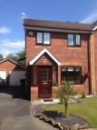 semi detached property in 33 Yew Tree Close...