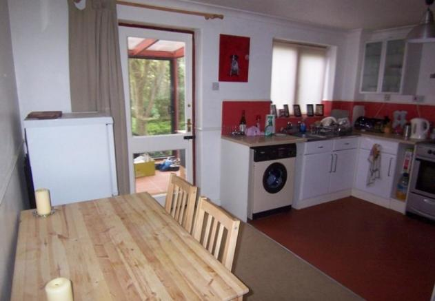 Kitchen showing dining area