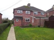 semi detached property in Honeymead Lane...