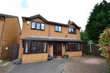 Detached property in Laxton Court...