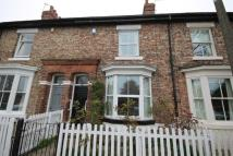 Terraced house in Harper Terrace, Hartburn...