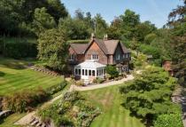 Detached home in Holmbury St. Mary...
