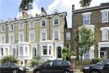 Terraced home for sale in Aspley Road, London...