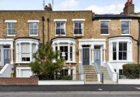 Terraced house in Riversdale Road, London...