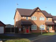 semi detached property in 27 Top Farm Road...