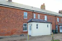 Terraced house in Coastguard Cottages...