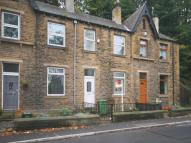 Terraced property in Meltham Road...