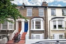 Terraced home in Brackenbury Road, W6