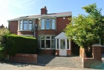 semi detached property in Moss House Road...