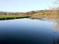 Land in Cowley Bridge Road...