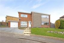 Detached home in Dorrofield Close...