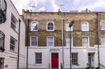 Terraced home in Tyndale Terrace, London...