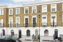 Terraced property in Gibson Square, Islington...