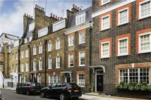 Terraced home in Buckingham Place, London...