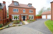 Detached home in Station Gardens, Scholes...