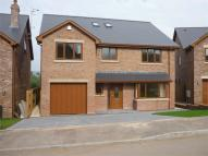 Detached property in Rhiw Franc Place...