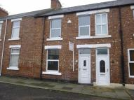 Terraced home in Ravensworth Avenue...