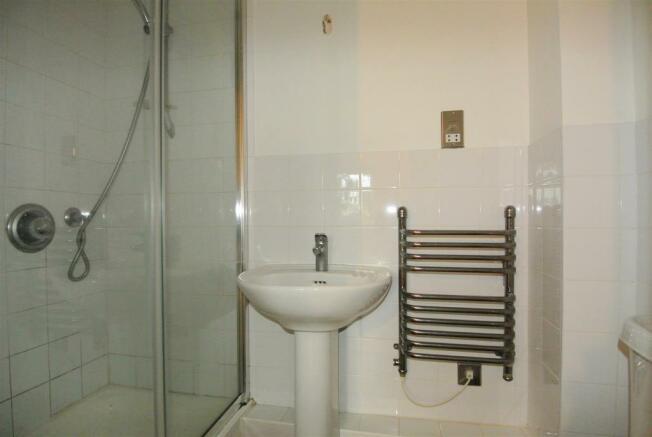 The ensuite has a double shower cubicle