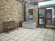 Cottage in Lothrop Street, London...