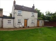 Detached property in High Street, Ringstead...