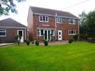 Detached property in Orchard Close...