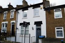 Terraced property in Bramblebury Road, London...