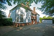 Detached property in Chipstead