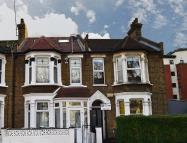Terraced property in Windsor Road, London...