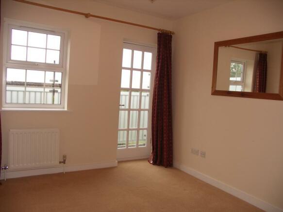 Double bedroom through to balcony