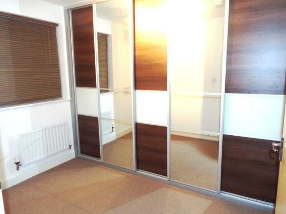 Second bedroom / Built-in Wardrobes