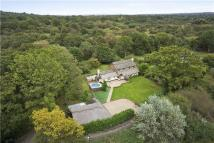 Detached home for sale in Little Bookham Common...