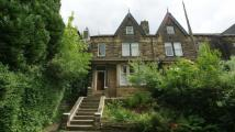 Flat in 14 Wetherby Road...