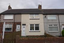 Terraced house in Cravens Cottages...