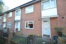 Terraced property in Wanborough Drive...