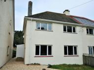 semi detached house in Slade Barton Cottages...